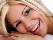 Picture of smiling blonde woman promoting laser gum surgery.